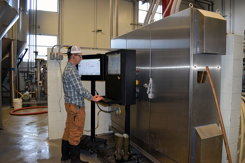 """Our PC Defender and 24"""" LCD Guardian installed on mobile pedestals side-by-side in a wet, beverage processing factory."""