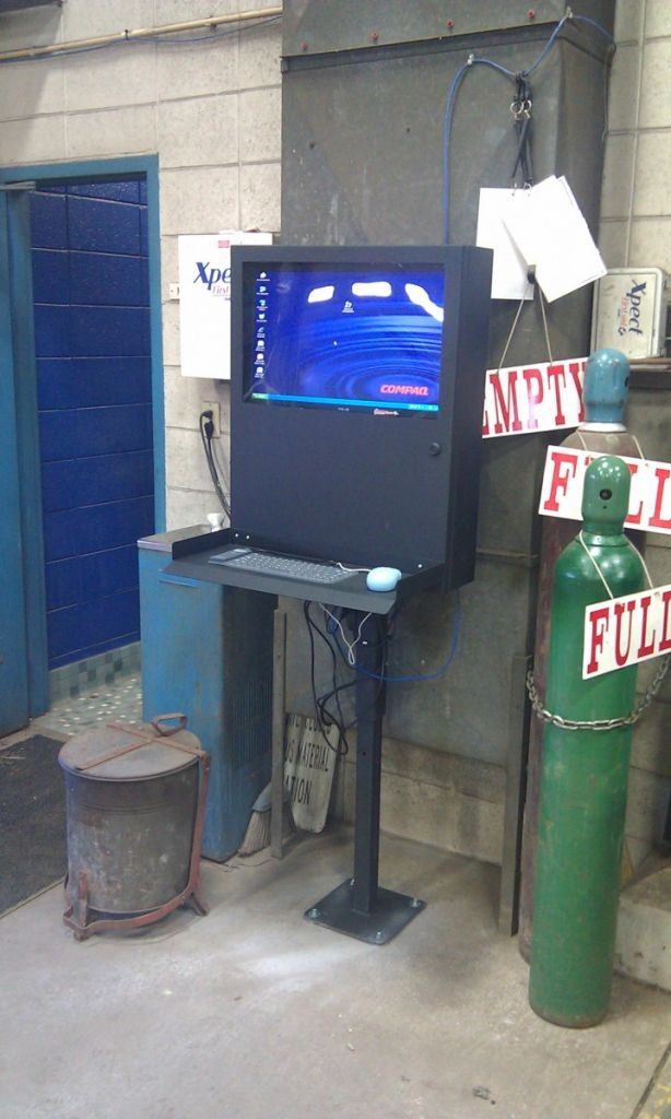 PC Defender on a pedestal in a factory.